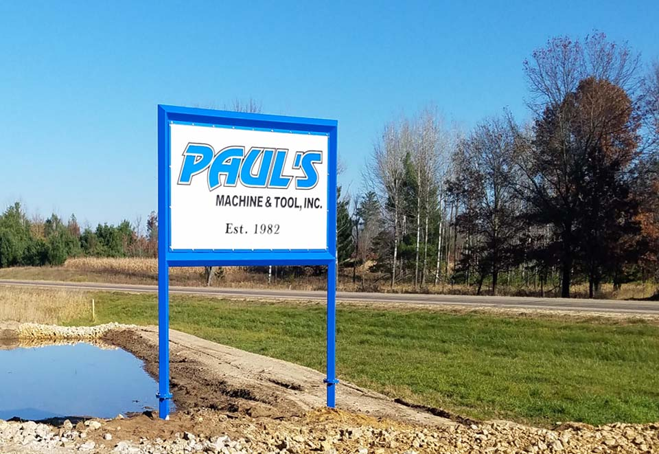 "road side sign to Paul's Machine "" Tool, Inc. of Warrens, WI"
